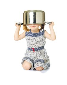 Free Little Cute Girl Holding Saucepan Over Her Head Royalty Free Stock Photo - 5769175