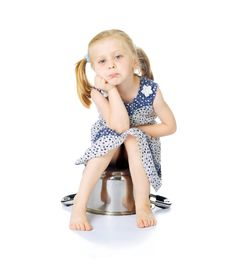 Free Little Cute Girl Sitting Over Saucepan Stock Image - 5769181