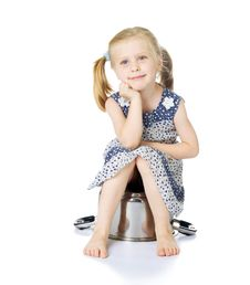 Free Little Cute Girl Sitting Over Saucepan Royalty Free Stock Image - 5769186