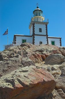 Free Lighthouse On The Rocks Stock Photography - 5769572
