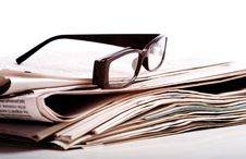 Free Reading Glasses On Newspapers Stock Photography - 5769612