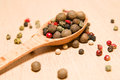 Free Spoon Filled With A Mixture Of Grains Of Pepper Are On A Wooden Royalty Free Stock Image - 57602906