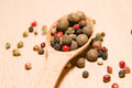Free Spoon Filled With A Mixture Of Grains Of Pepper Are On A Wooden Royalty Free Stock Photography - 57602947