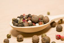Free Spoon Filled With A Mixture Of Grains Of Pepper Are On A Wooden Stock Photo - 57601520