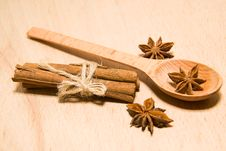 Spoon, Cinnamon And Star Anise On A Wooden Surface Royalty Free Stock Photo