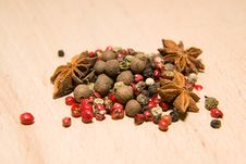 Free A Mixture Of Grains Of Pepper And Star Anise On A Wooden Surface Stock Image - 57601551