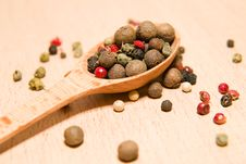 Spoon Filled With A Mixture Of Grains Of Pepper Are On A Wooden Royalty Free Stock Image