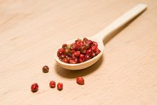 Free Spoon Filled With A Mixture Of Grains Of Pepper Are On A Wooden Stock Photography - 57603432