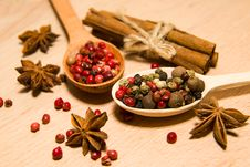 Free Spoons With A Mixture Of Grains Of Pepper, Cinnamon And Star Ani Stock Images - 57603444