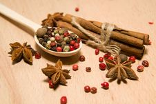 Spoon With A Mixture Of Grains Of Pepper, Cinnamon And Star Anis Stock Photo