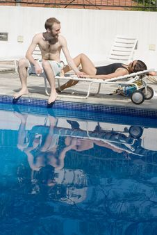 Free Man And Woman Lounging Beside A Pool - Vertical Stock Images - 5770974