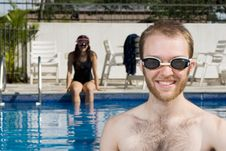 Free Man And Woman Sitting In Pool - Horizontal Royalty Free Stock Photo - 5771015