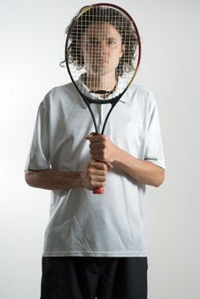 Free Man Holding Racket In Front Of His Face - Vertical Royalty Free Stock Photo - 5771325