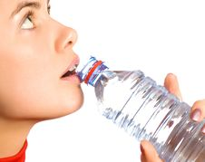 Young Beautiful Girl With Mineral Water Royalty Free Stock Photo