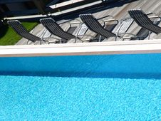 Free Pool And Deck Chairs Royalty Free Stock Images - 5772909