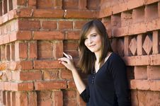 Free Happy Girl Against Brick Wall Stock Photo - 5773250