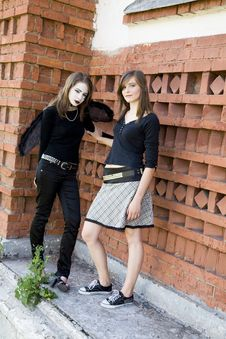 Two Young Women Near A Wall Stock Images