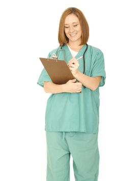 Free Nurse Write Something On The Clip Board Stock Image - 5776981