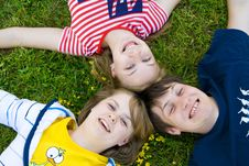 Free Three Friends Lay On A Grass Royalty Free Stock Images - 5777839