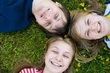 Free Three Friends Lay On A Grass Stock Images - 5777944
