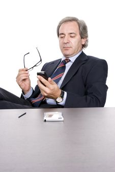 Free Mature Businessman Dialing A Number In Cellphone Royalty Free Stock Images - 5782269