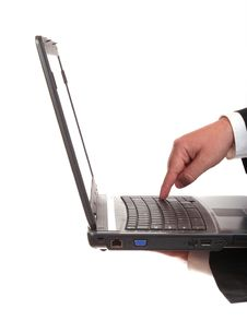 Businessman Finger On The Laptop S Keyboard Royalty Free Stock Images