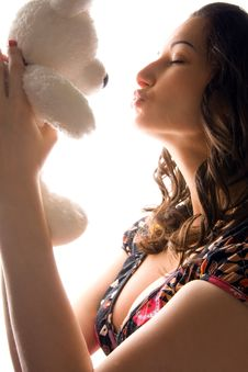 Free Woman Kissing A Bear Toy Stock Image - 5787511