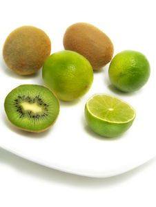 Kiwis And Limes On Plate Royalty Free Stock Photos