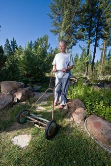 Senior Woman Mowing Lawn Royalty Free Stock Photo