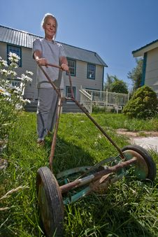 Senior Woman Mowing Lawn Royalty Free Stock Photos