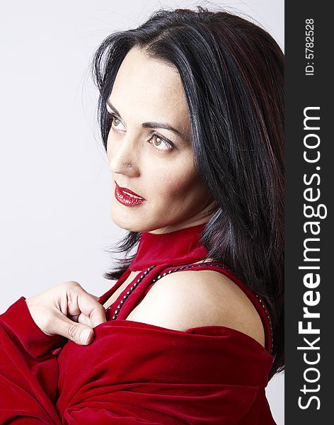 Beautiful brunette woman in a red dress