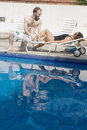 Free Couple On Pool Chair - Vertical Royalty Free Stock Photo - 5791675