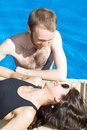 Free Couple In And Beside Pool - Vertical Stock Photo - 5791730