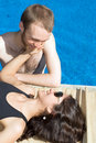 Free Couple Beside Pool - Vertical Royalty Free Stock Photos - 5792008