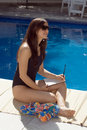Free Woman Sitting By Pool - Vertical Royalty Free Stock Photo - 5792145