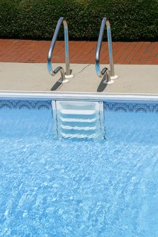 Ladder Into Swimming Pool Royalty Free Stock Photography