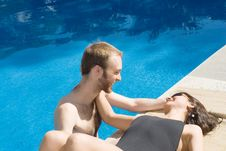 Free Couple Smiling Near And In Pool - Horizontal Royalty Free Stock Image - 5791686