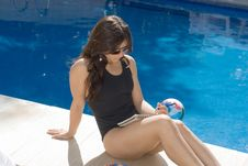 Free Young Woman Writing By Pool - Horizontal Stock Images - 5791734