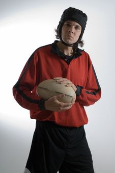 Man Holding Rugby Ball - Vertical Stock Image