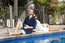 Free Man And Woman Lounging Beside A Pool - Horizontal Royalty Free Stock Images - 5792039