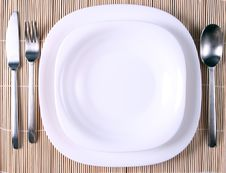 Free A White Plate With Cutlery Stock Images - 5796174