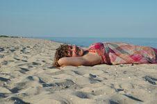 Free Smiling Girl Lying On Beach Stock Image - 5796571