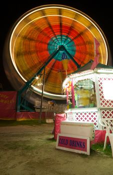 Snack Bar And Ferris Wheel Stock Photography