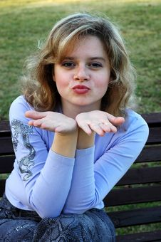 Free Girl Blowing A Kiss Royalty Free Stock Image - 583256