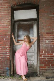 Free Beautiful Young Woman In Grunge Doorway Stock Images - 584384