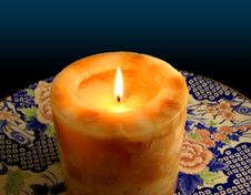 Free Candle On China Plate Stock Image - 586601