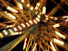 Free Close Up Of Spinning Ferris Wheel Royalty Free Stock Image - 589886