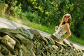 Free Pretty Girl Next To Stone Fence Royalty Free Stock Photo - 5802025