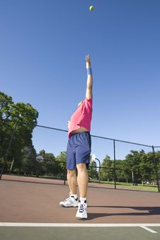 Man On Tennis Court Playing Tennis Royalty Free Stock Image