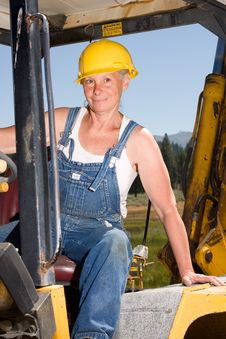 Free Woman Driving Backhoe Stock Images - 5801264